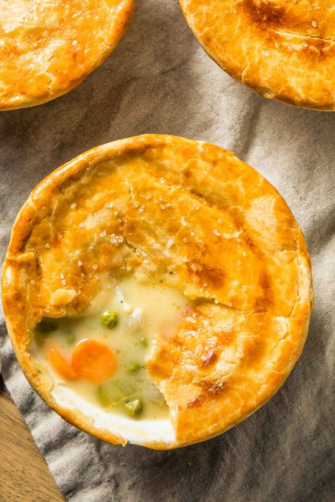 a closeup of individual instant pot chicken pot pies on a beige napkin